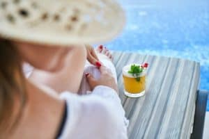 woman at resort hotel pool with drink